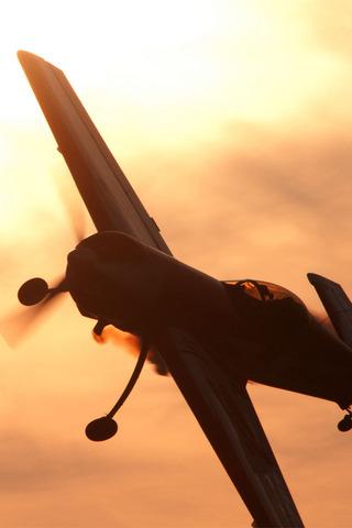 レッドブル フライト・パフォーマンス ユルギス・カイリス Su-26 iPhone 4 対応壁紙画像